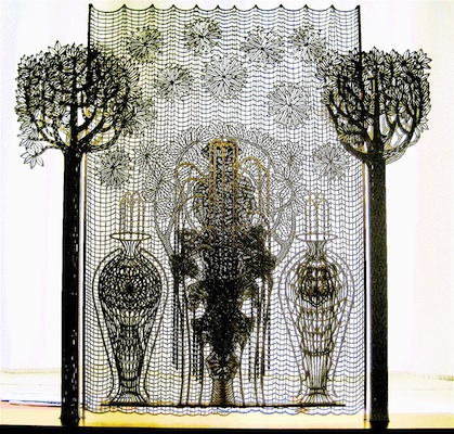 The fountain, year: 2011, size: 95x90x10cm, material: paper sculptur, paper cut, gold on paper - paper - wood - glue, photographer: private